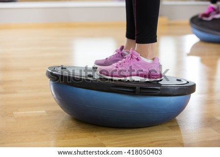 Low Section Of Woman Exercising On Bosu Ball - stock photo