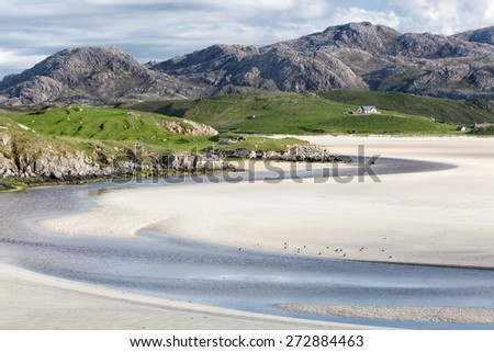 Low tide at Uig Beach on the Isle of Lewis and Harris, Outer Hebrides in Scotland - stock photo