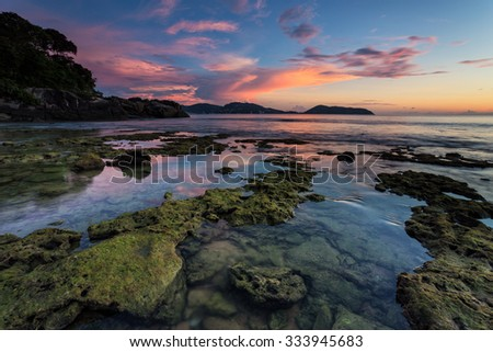 Low tide during sunset on Thavorn beach in Phuket - stock photo