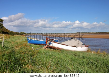 Low Tide on the River Severn in England with Boats moored on the Bank - stock photo