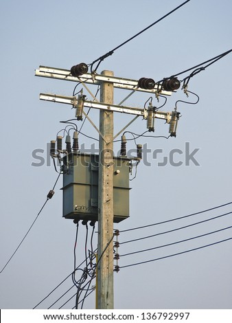 low voltage electricity post and Transformers in daytime - stock photo
