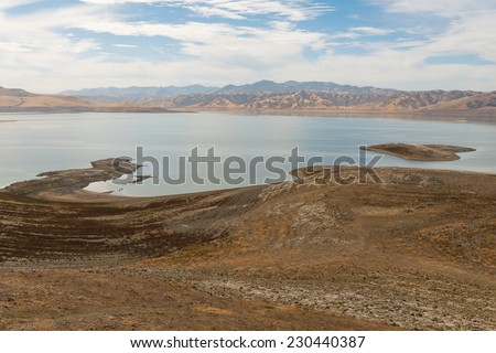Low water level in San Luis Reservoir near Los Banos, California - stock photo