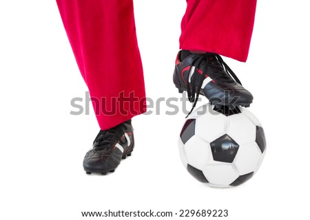 Lower half of santas legs with football boots and football on white background - stock photo