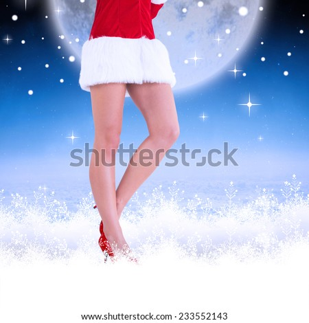 Lower half of sexy santa girl against white clouds under blue sky - stock photo