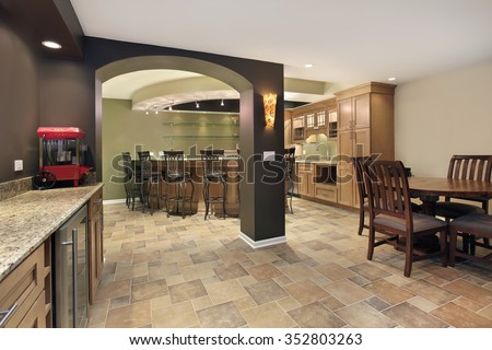 Lower level basement with bar and chairs - stock photo