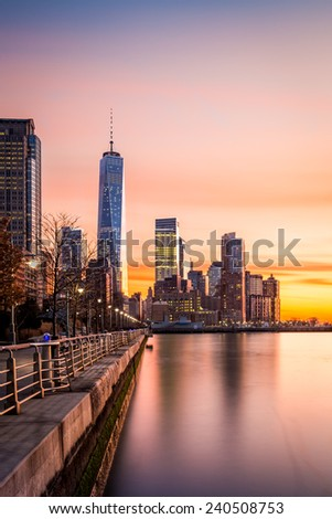 Lower Manhattan at sunset as viewed from Hudson River Park, in Tribeca, New York - vertical view - stock photo