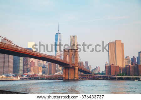 Lower Manhattan cityscape with the Brooklyn bridge - stock photo