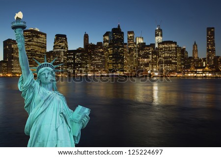 Lower Manhattan in the night. The concept of the Statue of Liberty.  (New York City, USA) - stock photo