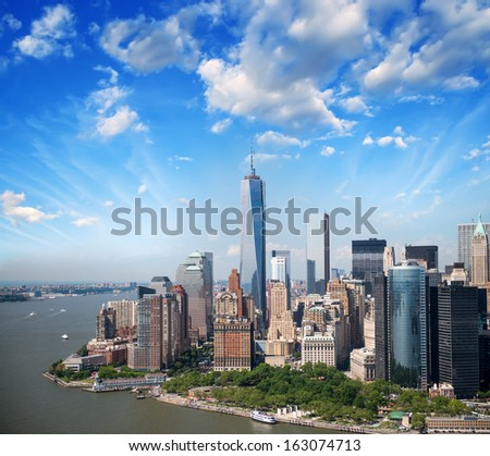 Lower Manhattan skyline and buildings. Beautiful aerial view at sunset. - stock photo