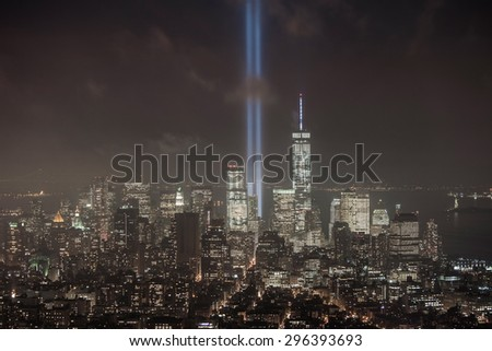 Lower Manhattan Skyline and the Towers of Light at night - stock photo