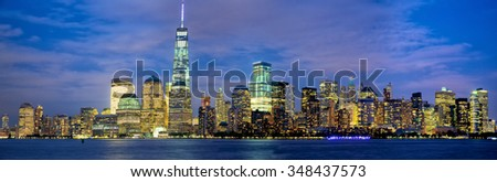 Lower Manhattan skyline panorama at dusk, New York - stock photo