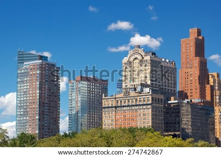 Lower Manhattan towers in the afternoon sun in the Financial District of New York, NY, USA. - stock photo