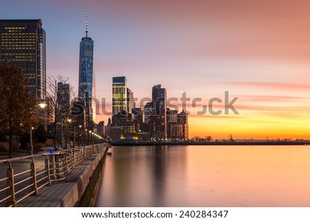 Lower Manhattanat sunset as viewed from Hudson River Park, in Tribeca, New York - with space for text on the right - stock photo
