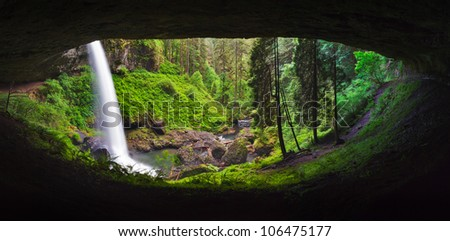 Lower North Falls in Silverton Springs State Park in Oregon allows for a behind the falls view. - stock photo