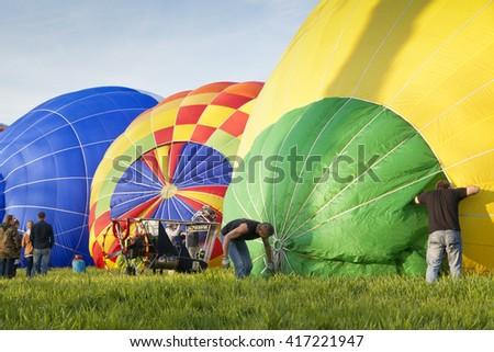 LOWER SILESIA, POLAND- APRIL 30, 2016:Hot Air Balloon festival. Start of hot air balloons in Krzyzowa,a village in Lower Silesia region in Poland. - stock photo