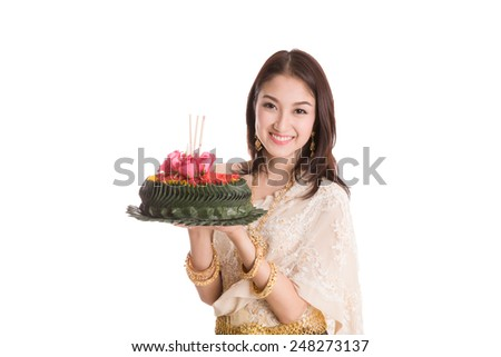 Loykratong tradition, Thai woman hold kratong - stock photo
