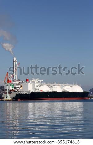LPG cargo ship docked in the port - stock photo