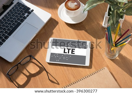 LTE CONCEPT on tablet on screen, table and coffee Business - stock photo