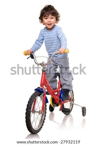 Lttle boy riding bicycle - stock photo