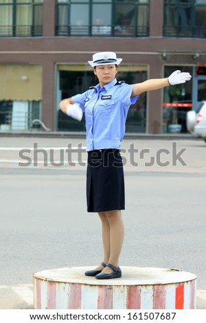 http://thumb101.shutterstock.com/display_pic_with_logo/694342/161507687/stock-photo-luannan-county-september-female-traffic-police-were-directing-traffic-in-the-street-on-161507687.jpg