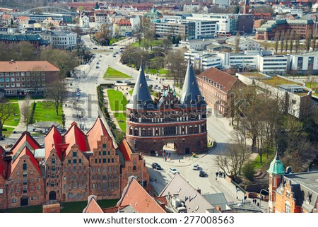 LUBECK, GERMANY - APRIL 5, 2015: Holstentor Gate in Lubeck old town, is the second largest city in Schleswig-Holstein, northern Germany. - stock photo