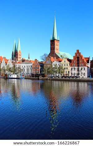 Lubeck old town with Marienkirche (St. Mary's Church) and Petrikirche (St. Peter's Church) reflected in Trave river, Germany - stock photo