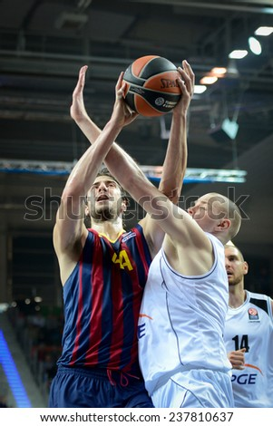 LUBIN, POLAND - DECEMBER 5, 2014:  Ante Tomic and Damian Kulig in action during the Euroleague basketball match between PGE Turow Zgorzelec - FC Barcelona 65:104. - stock photo