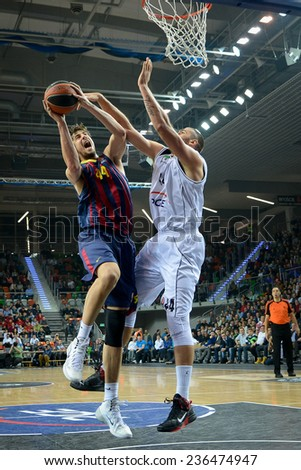 LUBIN, POLAND - DECEMBER 5, 2014:  Ante Tomic (L) and Ivan Zigeranovic (R) in action during the Euroleague basketball match between PGE Turow Zgorzelec - FC Barcelona 65:104. - stock photo