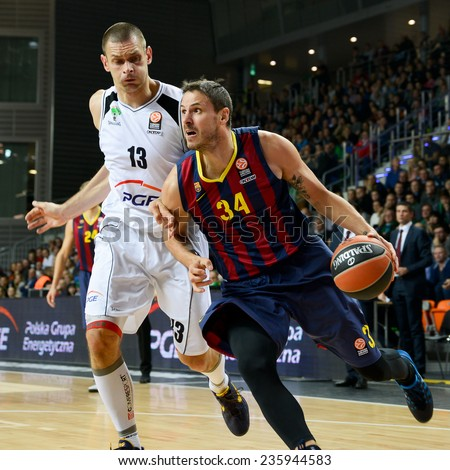 LUBIN, POLAND - DECEMBER 5, 2014:    Filip Dylewicz (L) and Bostjan Nachbar (R) in action during the Euroleague basketball match between PGE Turow Zgorzelec - FC Barcelona 65:104. - stock photo