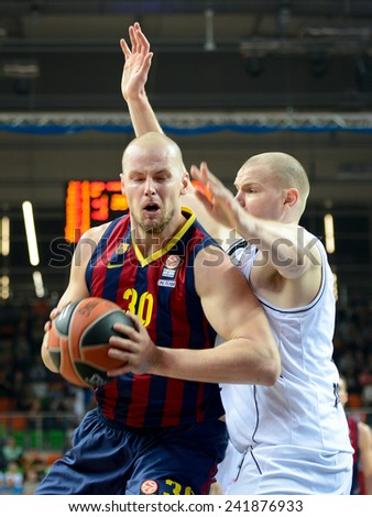LUBIN, POLAND - DECEMBER 5, 2014:  Maciej Lampe and Damian Kulig in action during the Euroleague basketball match between PGE Turow Zgorzelec - FC Barcelona 65:104. - stock photo
