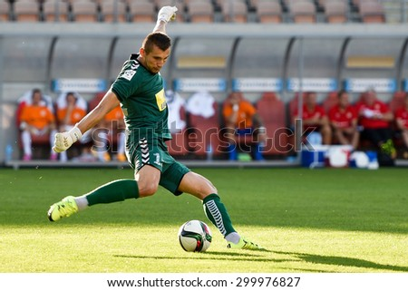 LUBIN, POLAND - JULY 25, 2015:Goalkeeper Dariusz Trela shotting during match Polish Premier League between KGHM Zaglebie Lubin - Korona Kielce 0:2. - stock photo