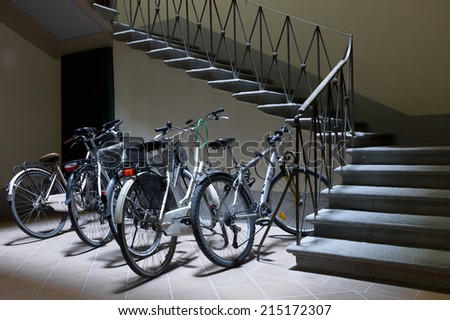 LUCA, ITALY - MAY 7, 2014: Bikes parked in the basement of an Italian house in on May 7, 2014 in Luca, Italy - stock photo