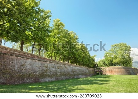 Lucca medieval city and surrounding city walls, Italy - stock photo