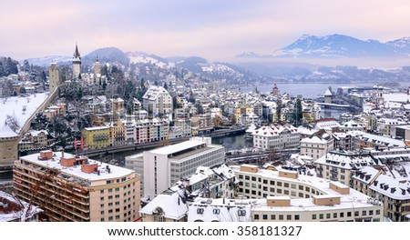 Lucerne, Switzerland, aerial view of the old town, city wall towers, lake Lucerne and Rigi mountain in background - stock photo
