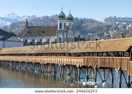 Lucerne, Switzerland - 8  December, 2013: cityscape with the Chapel Bridge and the Jesuit Church in the morning. Lucerne is a city in Switzerland, it is the capital of the canton of Lucerne.  - stock photo
