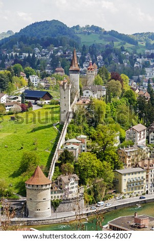 LUCERNE, SWITZERLAND - MAY 04, 2016: Towers of Lucerne's ancient city walls. These historic fortifications are called Musseg and are mostly very well preserved - stock photo