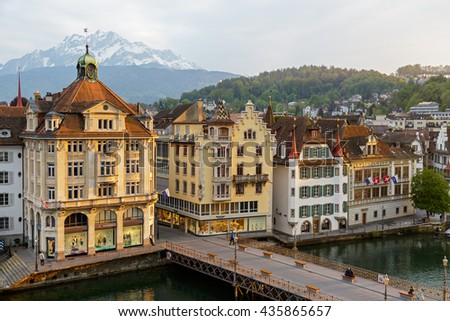 LUCERNE, SWITZERLAND - MAY 02, 2016: Townhouses down by the river Reuss shows the unique character of the city and variety of sightseeing attractions. The town is a destination for many travelers - stock photo