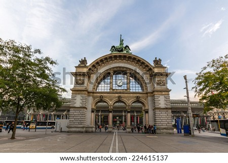 LUCERNE, SWITZERLAND - SEP 16, 2014: Luzern railway station. Luzern is a famous tourist destination due to its location on the shore of Lake Lucerne within sight of Swiss Alps. - stock photo