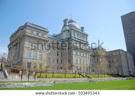 Lucien-Saulnier Building (Edifice Lucien-Saulnier), next to Montreal City Hall in Old Montreal, Quebec, Canada - stock photo