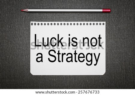 Luck Is Not A Strategy text on a sheet of paper - stock photo