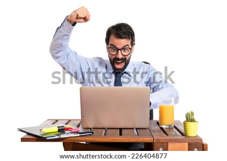 Lucky businessman in his office - stock photo