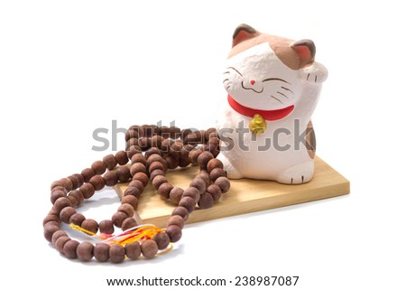 Lucky Cat and bead isolated on white background - stock photo