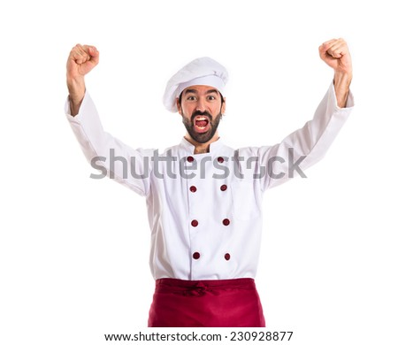 Lucky chef over isolated white background - stock photo