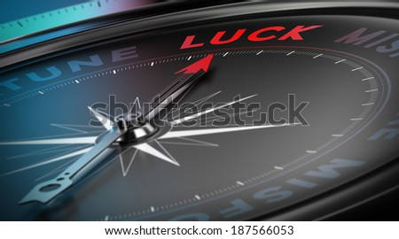 Lucky concept, Compass needle pointing the  word luck over black background, blur effect - stock photo