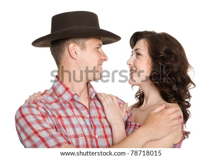 Lucky girl and a guy in a cowboy hat. - stock photo