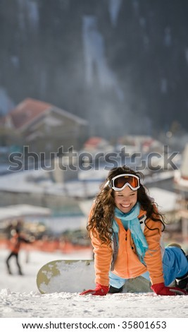 Lucky girl snowboarder in a mountain valley - stock photo