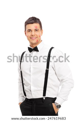 Lucky guy with a few kiss marks on his face isolated on white background - stock photo