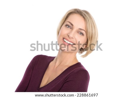 Lucky isolated blond mature woman with white teeth and pullover in bordeaux color. - stock photo