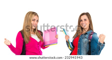 Lucky students over isolated white background   - stock photo
