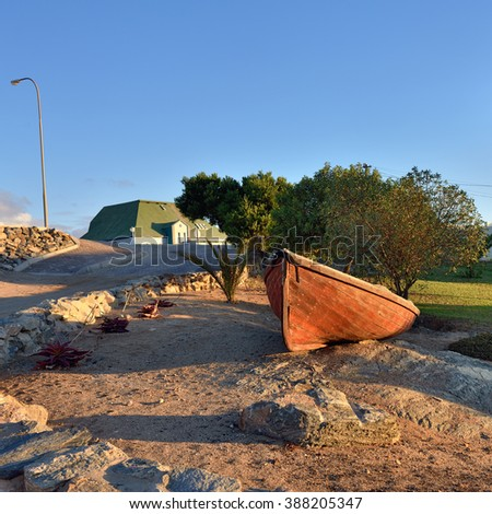 Luderitz street scene, old boat at sunset. Luderitz is a harbour town in southwest Namibia, lying on one of the least hospitable coasts in Africa - stock photo